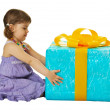 Girl with a big gift box on white background — Stock Photo