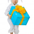 Child dressed as a rabbit with a jumbo gift — Stock Photo