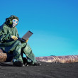 Scientist with a laptop on chemically contaminated area — Stock Photo