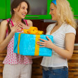 Two young girls with a gift — Stock Photo