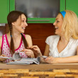 Royalty-Free Stock Photo: Two girlfriends with magazines