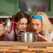 Two young women with a pot of soup — Stock Photo #12041329