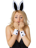 Frightened young girl in rabbit costume isolated on white — Stock Photo