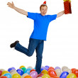 Dancing happy man with a christmas gift — Stock Photo