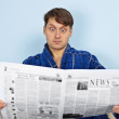 Stock Photo: Mreads newspaper with admiration