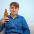 Man relaxing with a bottle of beer — Stock Photo