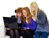 Female teenagers with a laptop — Stock Photo