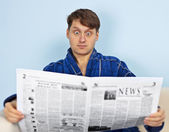 Man reads a newspaper with a admiration — Stock Photo