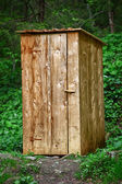 Rustic wooden toilet in the forest — Stock Photo