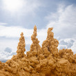 Stock Photo: Sand castles on sky background