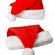 Christmas Santa Claus red hats on white - Stock Photo