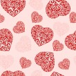 Vector Illustration of a seamless hearts pattern. — Imagens vectoriais em stock