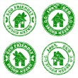 Vector illustration of a set of green eco friendly house  stamps — Stock Vector