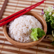 Rice in bamboo bowl with chopsticks — Stock Photo
