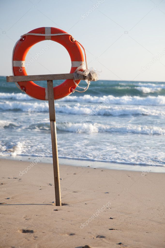 Lifebuoy on a beach of the sea — Stock Photo #11876756