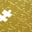 Gold puzzle — Stock Photo #11613851