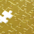 Stock Photo: Gold puzzle