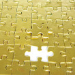 Gold puzzle — Stock Photo #11613860