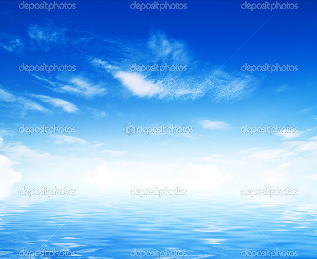 White fluffy clouds with rainbow in the blue sky  Stock Photo #12315427