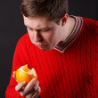 The guy squeezes the juice from the orange — Stock Photo #10792512
