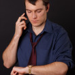 Businessman on the phone looking at his watch — Stock Photo #10793872