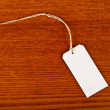 Blank tag on wooden background. - Zdjęcie stockowe