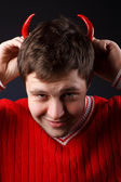 Young man with red horns made of pepper — Stock Photo