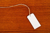 Blank tag on wooden background. — Stock Photo