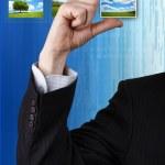 Businessman holding a photo — Stock Photo