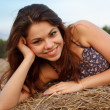Portrait of a beautiful girl on hay — Stock Photo