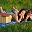 Two beautiful girls at a picnic — Stock Photo