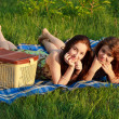 Two beautiful girls at a picnic — Foto de stock #10829865