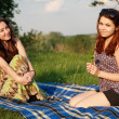 Стоковое фото: Two beautiful girls at a picnic