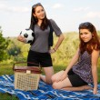 Two beautiful girls at a picnic — Foto de stock #10830177
