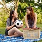 Two beautiful girls at a picnic — Stock Photo #10830232