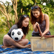 Two beautiful girls at a picnic — Foto de stock #10830348