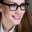 Stock Photo: Beautiful business womwith glasses. Close-up portrait