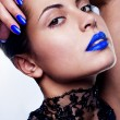 Sexy and beautiful woman with blue make up — Stock Photo