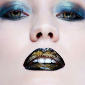 Close-up portrait of beautiful caucasian young woman with pearl glamour make-up and black lips — Stock Photo