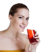 Happy young beautiful female holding glass of fresh juice — Stock Photo