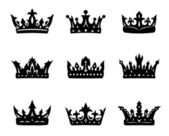 Black heraldic royal crowns — Stock Vector