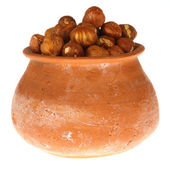 Ceramic pot with nuts — Stock Photo