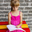 Girl draws on the album sitting bench — Stock Photo #12288295