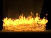 Golden silk drapery in the fire — Stock Photo