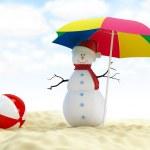 Snowman on a beach — Stock Photo