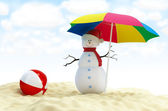 Snowman on a beach — Stock Photo