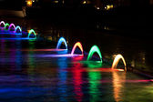 Dancing Multi Colored fountain at dark night — Stock Photo