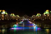 Dancing Multi Colored fountain at dark night — Stock Photo