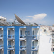 Satellite Dishes on the top of Roofs — Stock Photo #11583040