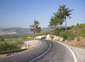 Mountain road with dangerous curves — Stock Photo